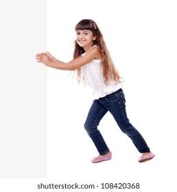 Full length portrait of girl pushing the blank board