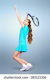 Full length portrait of a girl tennis player in motion. Studio shot.