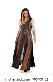 full length portrait of girl wearing brown  fantasy costume. standing pose facing the camera, on white studio background.