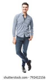 Full length portrait of a good looking and confident young Hispanic man looking relaxed in a studio