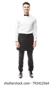 Full length portrait of a good looking waiter wearing a bowtie and an apron