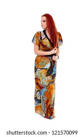 Full length portrait of a gorgeous redhead woman in a long dress isolated on white background