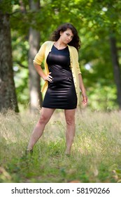 Full length portrait of a gorgeous young lady outdoor in the forest