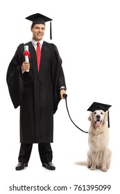 Full length portrait of graduate student with a diploma and a dog wearing a graduation hat isolated on white background