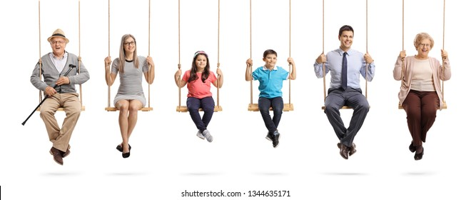 Full length portrait of grandparents, parents and children sitting on swings and smiling at the camera isolated on white background