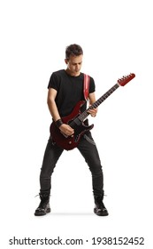 Full length portrait of a guy playing an electric guitar isolated on white background