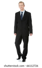 Full length portrait of a handsome business man standing against white background