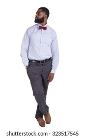 Full length portrait of a handsome man dressed nicely and looking to his right isolated on white