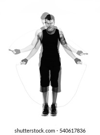 Full length portrait of a handsome man jumping with skipping rope isolated on a white background. Looking at camera