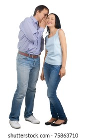 Full length portrait of a handsome young man whispering in his girlfriend ear