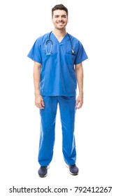 Full length portrait of a handsome young health professional wearing scrubs and smiling in a studio