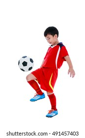 Full length portrait of happy asian soccer player in red uniform bounce his soccer ball, studio shot. Isolated on white background.