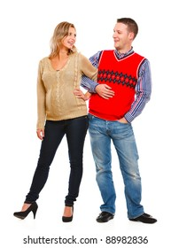 Full length portrait of happy beautiful pregnant woman with husband on white background