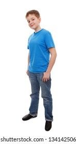 Full length portrait of a happy boy standing isolated over white background