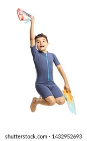Full length portrait of a happy boy in a wetsuit holding swmming fins and jumping isolated on white background