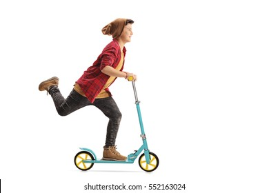 Full length portrait of a happy boy riding a scooter isolated on white background