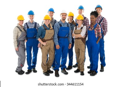 Full length portrait of happy carpenters standing against white background
