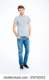 Full length portrait of a happy casual man standing isolated on a white background