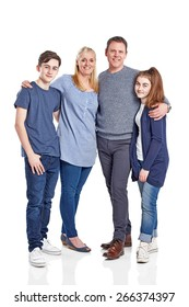 Full length portrait of happy caucasian family of four standing together on white background