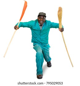 Full length portrait of happy dancing african garden worker in green overall. Man holding broom and rake isolated on white background.