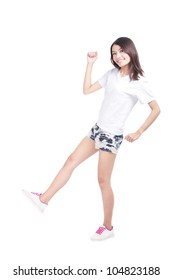 Full length portrait of happy excited girl with white t-shirt and blue jeans isolated over white background, model is a asian woman
