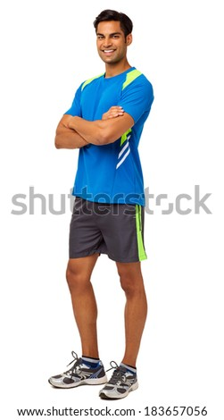 Full length portrait of happy fit man standing arms crossed over white background. Vertical shot.