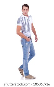 Full length portrait of happy handsome young casual man isolated on white background