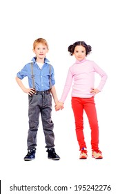 Full length portrait of a happy little girl and boy standing together. Children. Isolated over white.