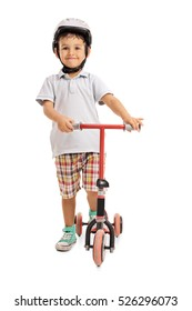 Full length portrait of happy little boy with a helmet and a scooter isolated on white background