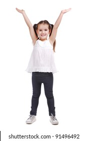 Full length portrait of a happy little girl standing with hands raised on white background