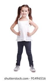 Full length portrait of a happy little girl on white background