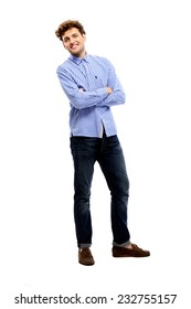 Full length portrait of a happy man with arms folded over white background