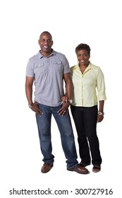 Full length portrait of a happy older couple isolated on white.