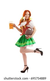 A Full Length Portrait of a Happy Sexy Woman Wearing a Traditional Octoberfest Costume Holding Large Beer Glass and Rugby ball Isolated on White Background
