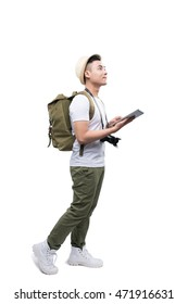 Full length portrait of happy tourist man using tablet on white background