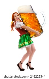 A Full Length Portrait of a Happy Woman Wearing a Traditional October fest Costume Holding a Huge Beer Glass Isolated on White Background