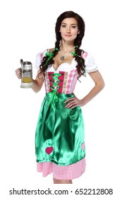 A full length portrait of a happy woman wearing a traditional october fest costume holding a beer glass Isolated on white background