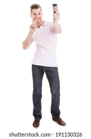 Full length portrait of a happy young man showing a peace sign and taking a SELFIE - isolated on white