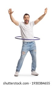Full length portrait of a happy young man playing with a hula hoop isolated on white background