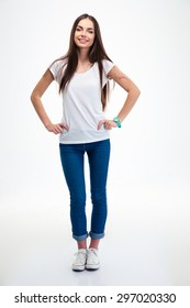 Full length portrait of a happy young woman standing isolated on a white background. Looking at camera
