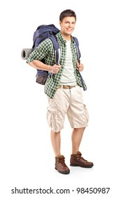 Full length portrait of a hiker with backpack posing isolated on white background