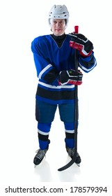 Full length portrait of hockey player with stick. On white background with shadow