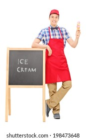 Full length portrait of an ice cream vendor standing by a blackboard isolated on white background