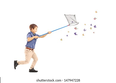 Full length portrait of a kid running and catching butterflies with net isolated on white background