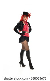 full length portrait of lady wearing cabaret, burlesque inspired costume, standing pose. isolated against white background.