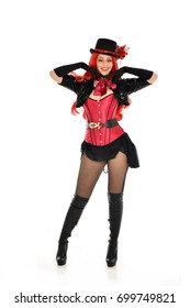 full length portrait of lady wearing cabaret burlesque inspired costume, standing pose. isolated against white background.