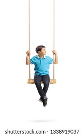 Full length portrait of a little boy sitting on a swing and looking to the side isolated on white background