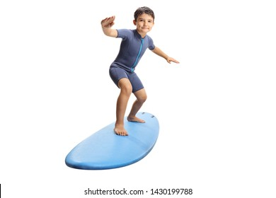 Full length portrait of a little boy surfing on a surfboard isolated on white background