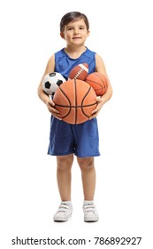 Full length portrait of a little boy holding sports balls isolated on white background