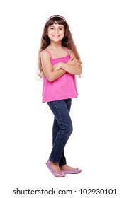 Full length portrait of a little girl standing with folded hands over white background